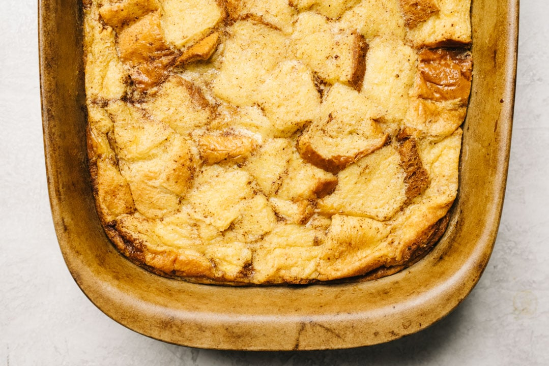 Baked french toast casserole fresh from the oven in a 9x13 casserole dish.