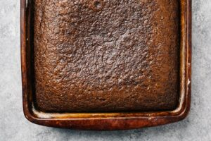 """Baked gingerbread cake fresh from the oven in a 9x13"""" cake pan."""