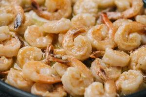 Cooked shrimp scampi in a skillet.