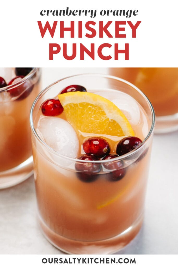 Pinterest image for a cranberry orange whiskey punch recipe.