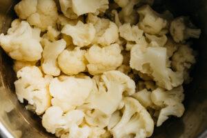 Steamed cauliflower florets in a pot.