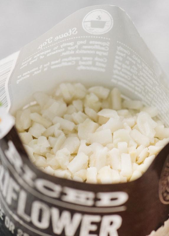 An open bag of frozen cauliflower rice.