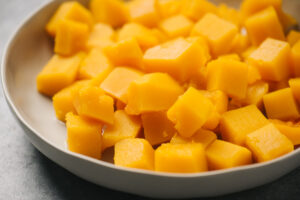 A bowl of steamed butternut squash cubes steamed in the instant pot.