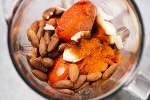 Romesco sauce ingredients in a blender.