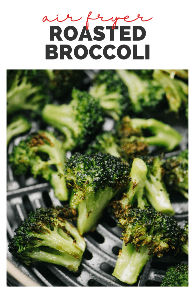 """Cooked broccoli florets in the basket of an air fryer with a title bar that reads """"air fryer roasted broccoli""""."""