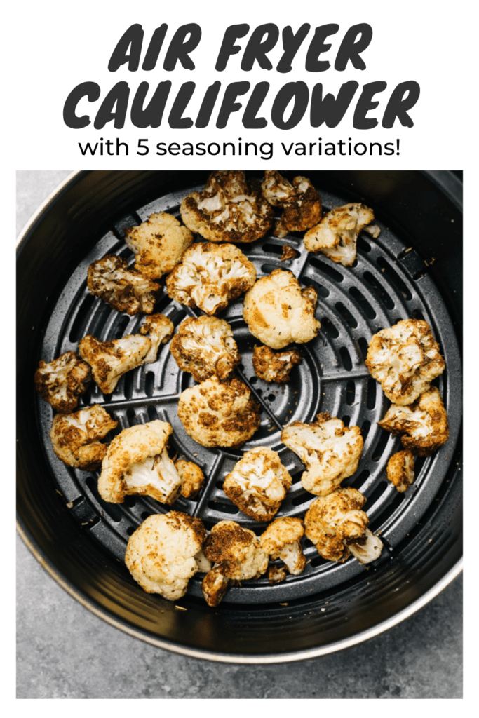 """Crispy roasted air fried cauliflower florets in the basket of an air fryer on a cement background with a title bar that reads """"Air Fryer Cauliflower with 5 seasoning variations""""."""