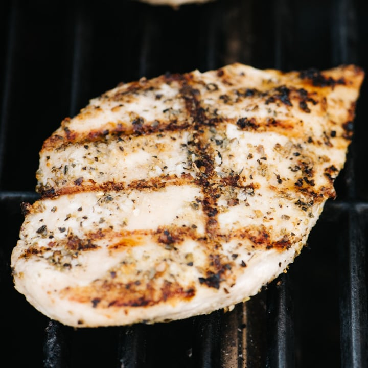 A grilled chicken breast on a grill.