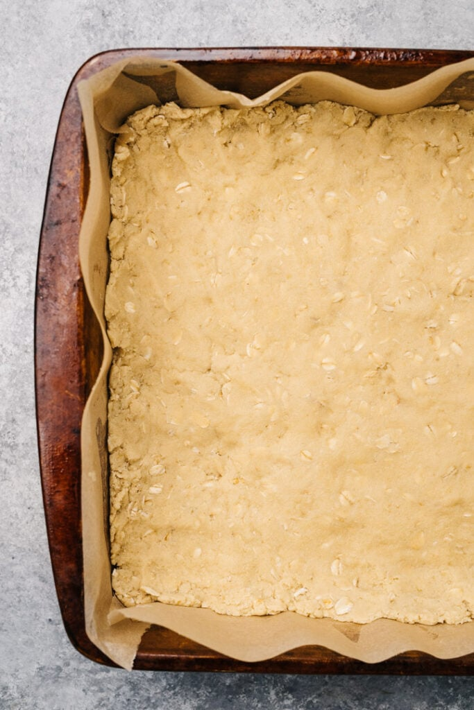 Crust pressed into a parchment lined baking dish.