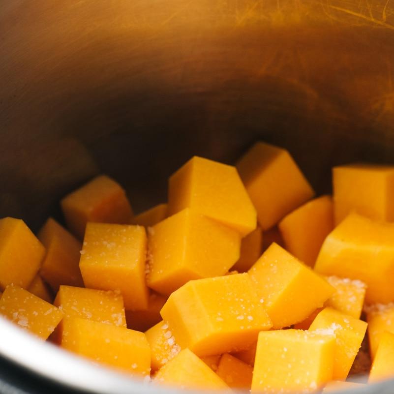 Diced butternut squash cubes in an instant pot.