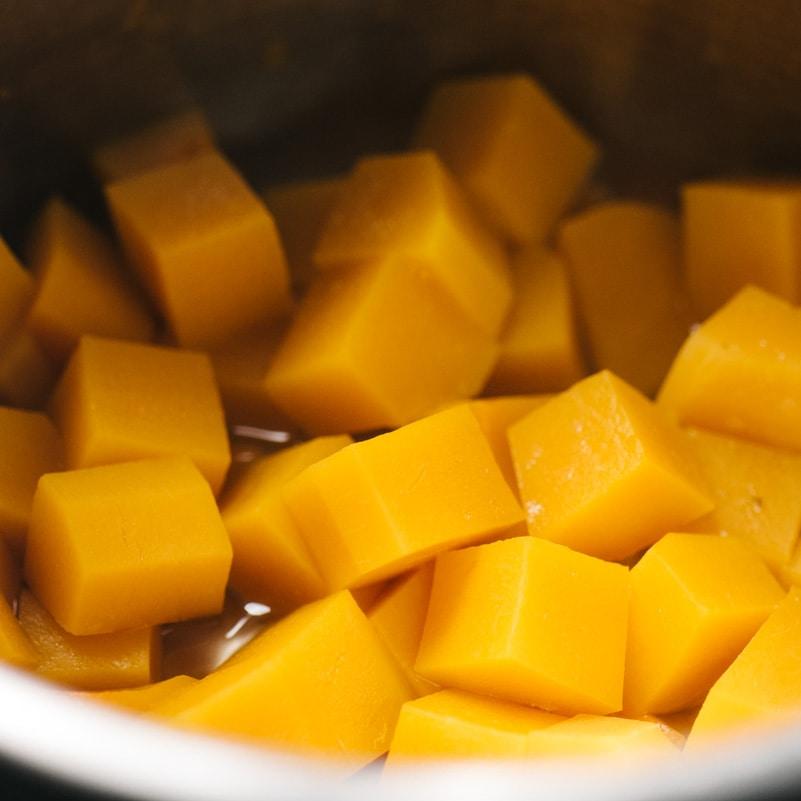 Steamed butternut squash cubes in an instant pot.