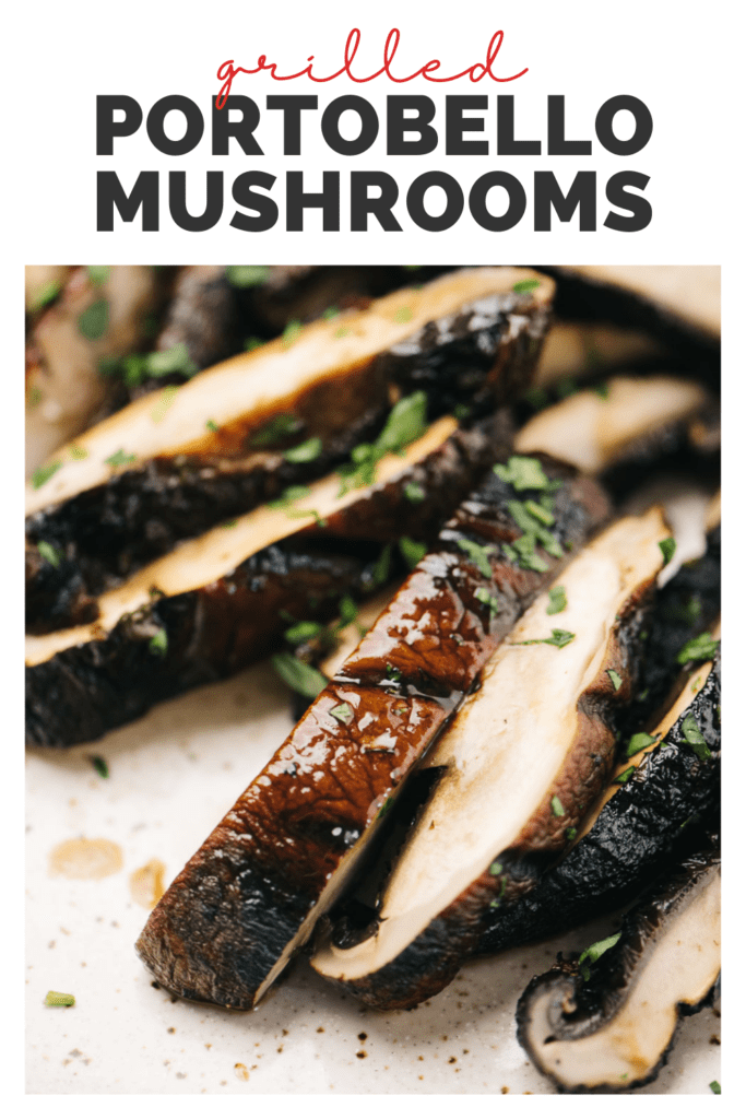 """Side view, sliced portobello mushrooms on a tan speckled plate, garnished with fresh herbs with a title bar that reads """"grilled portobello mushrooms"""""""