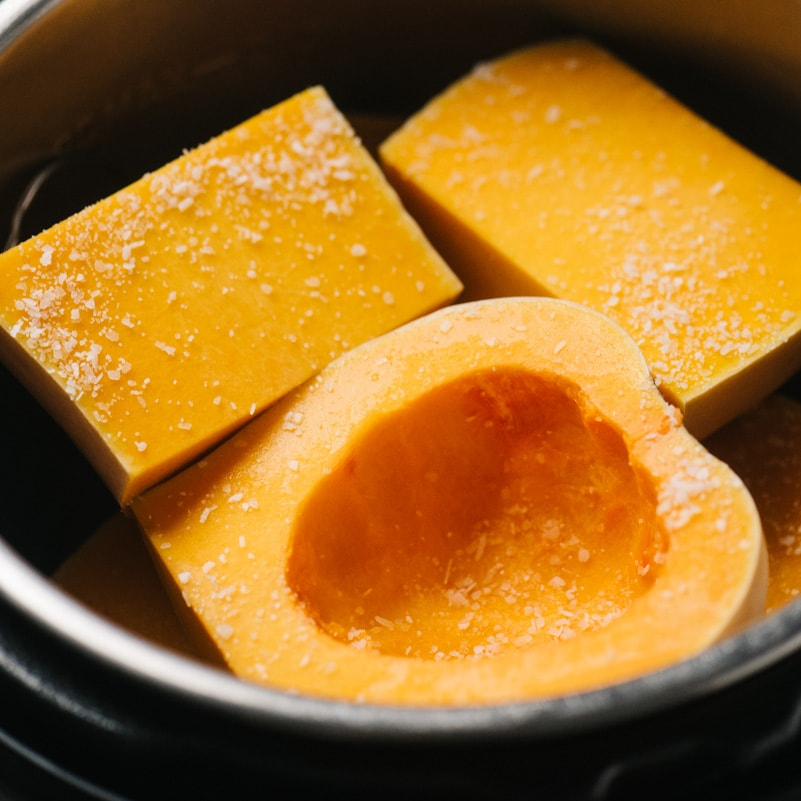 Whole chunks of butternut squash in an instant pot.