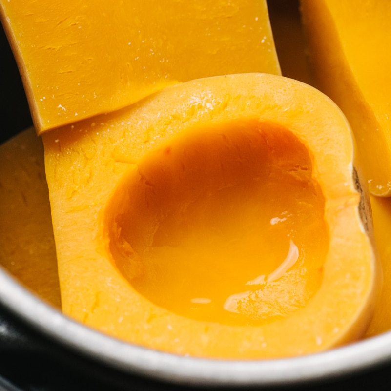 Whole steamed pieces of butternut squash in an instant pot.