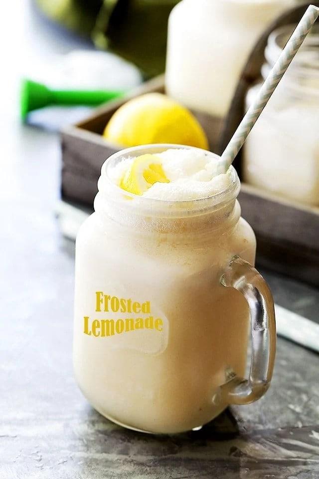 A mug of frozen lemonade with a metal straw.