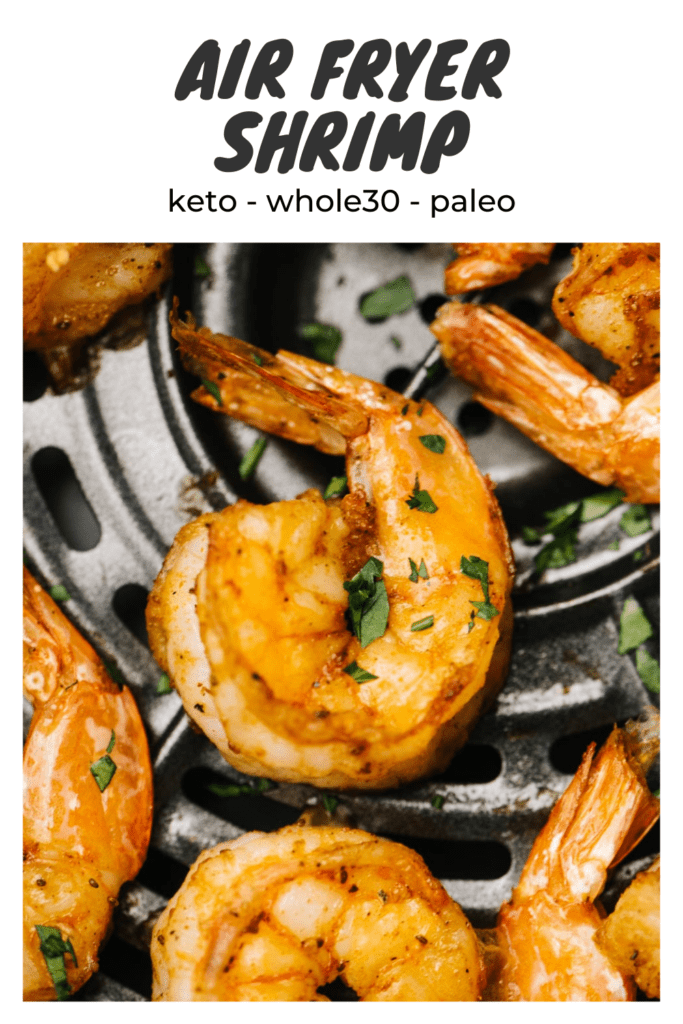 """Cooked shrimp in the basket of an air fryer, garnished with parsley - title bar reads """"air fryer shrimp - whole30, paleo, keto"""""""