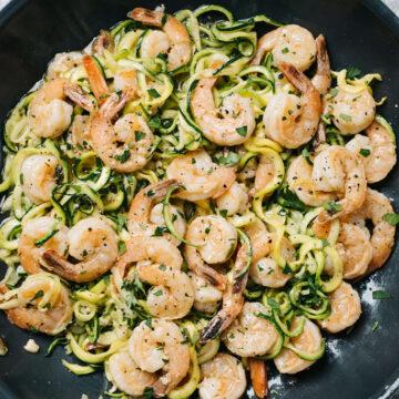 Keto shrimp scampi with zucchini noddles in a skillet.