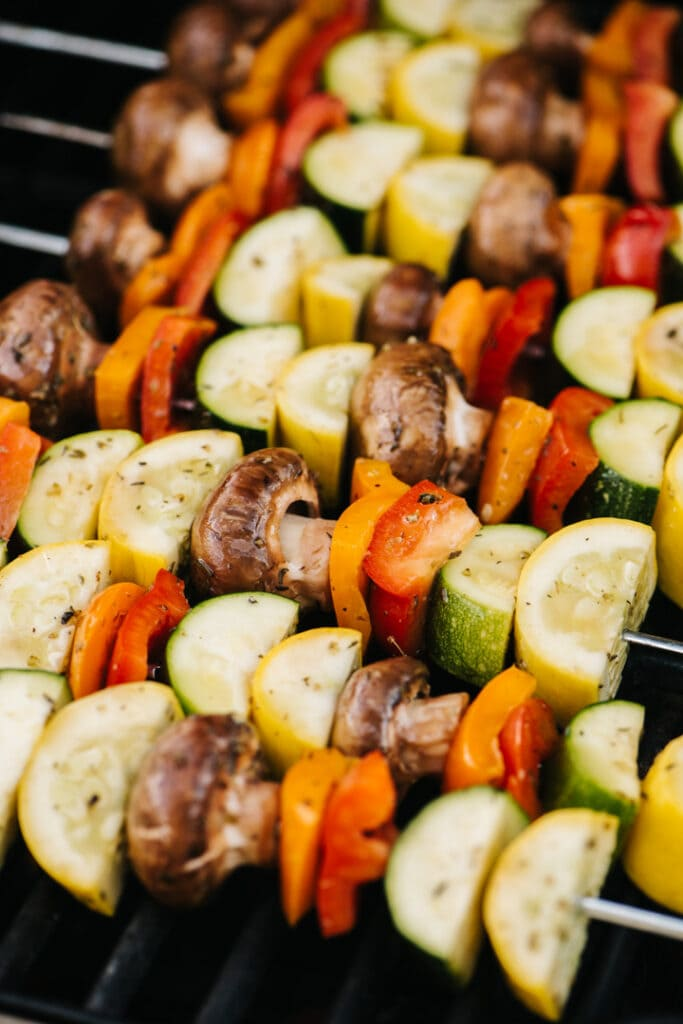 Veggie kabobs on a grill.
