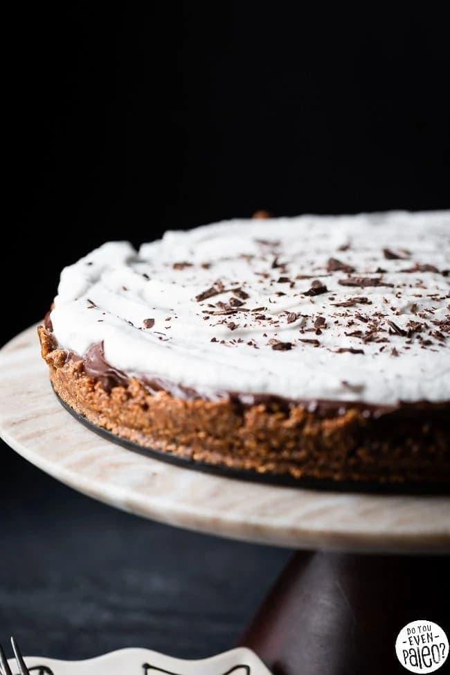 Mocha avocado cream pie on a cake stand.