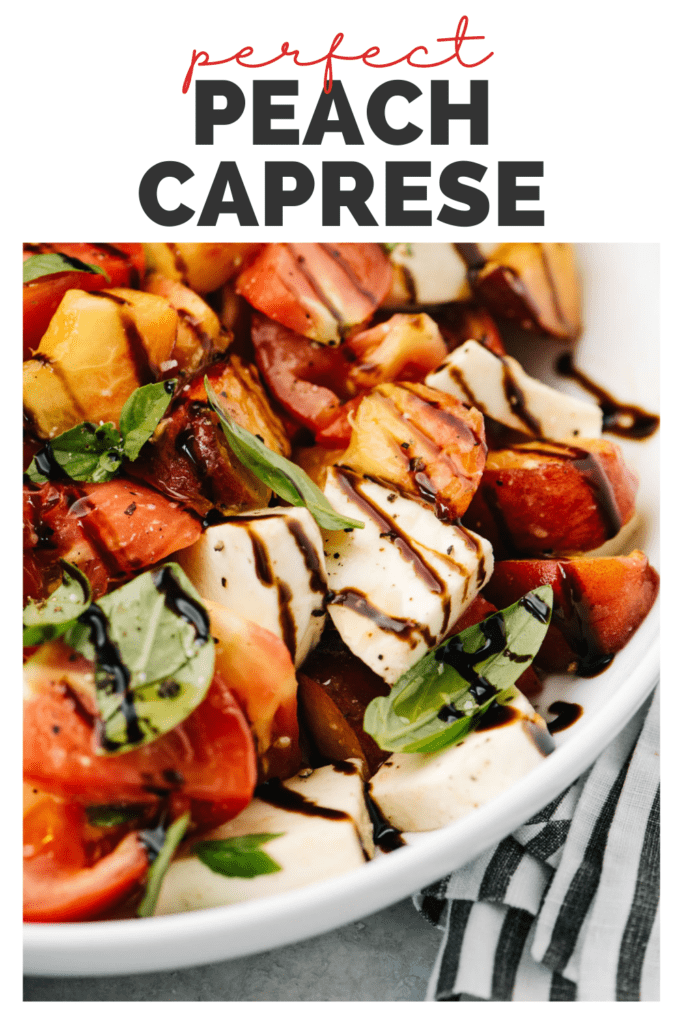 """Side view, peach caprese salad drizzled with balsamic reduction in a white serving bowl with a title bar that reads """"perfect peach caprese""""."""