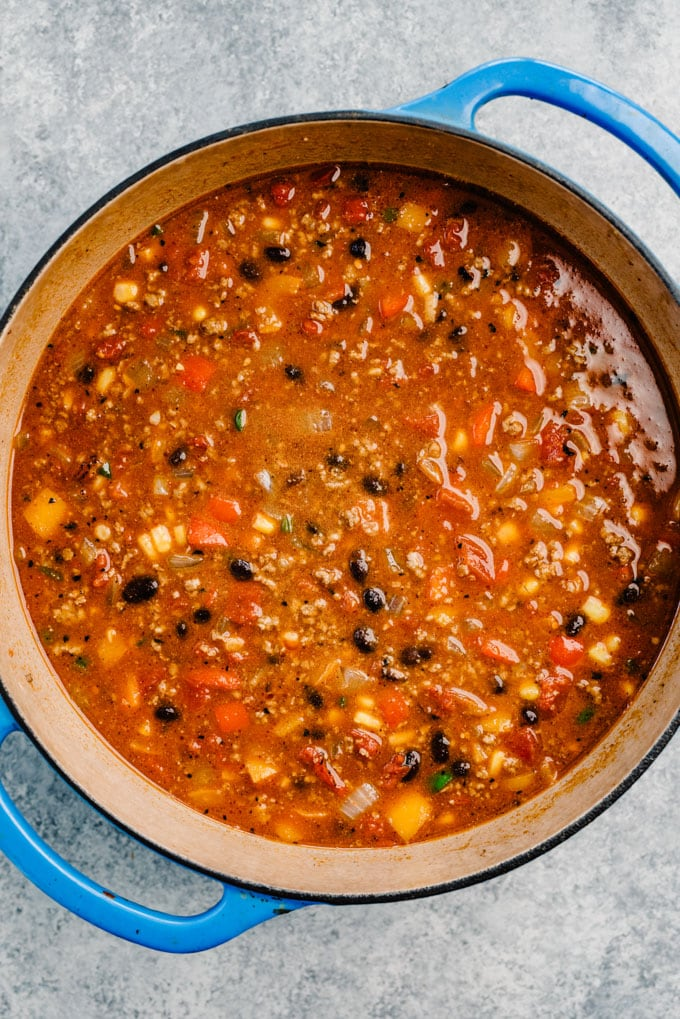 Taco soup in a blue dutch oven before simmering.
