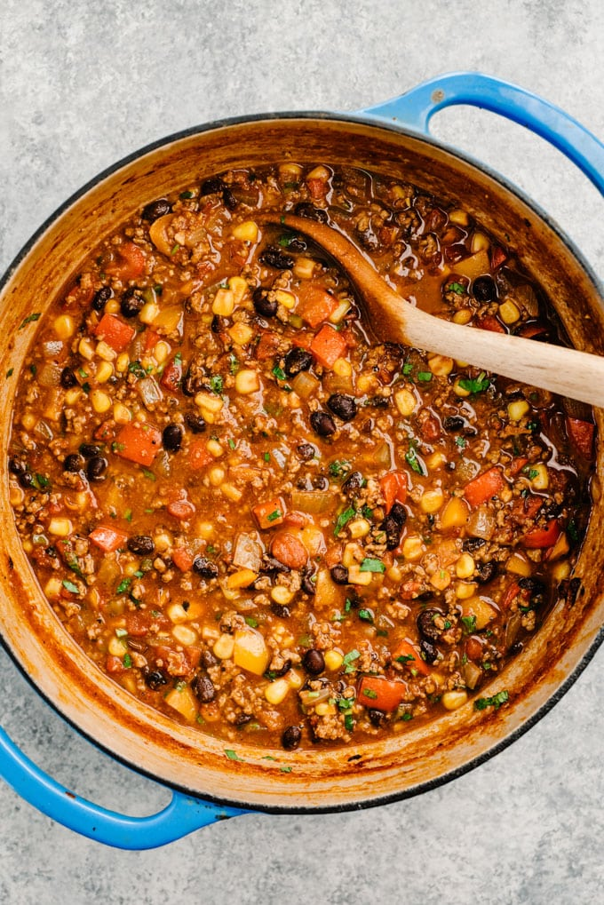 A large pot of easy taco soup with ground beef, black beans, and vegetables.