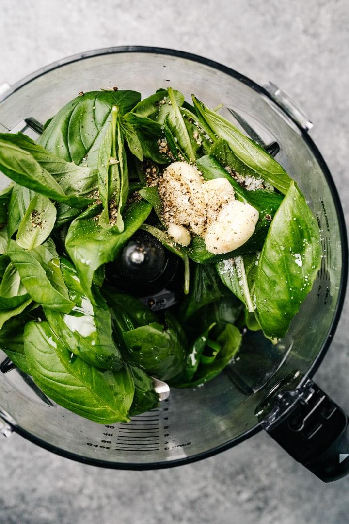 Basil, garlic, vinegar, and seasonings in a food processor.