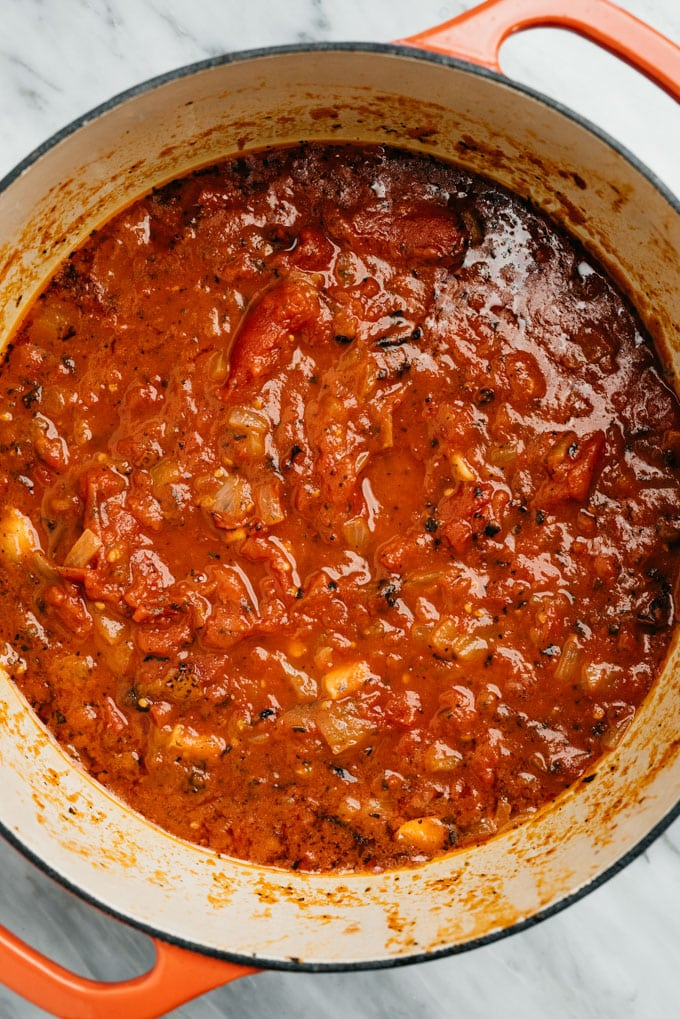 Homemade tomato sauce in a dutch oven before being pureed.